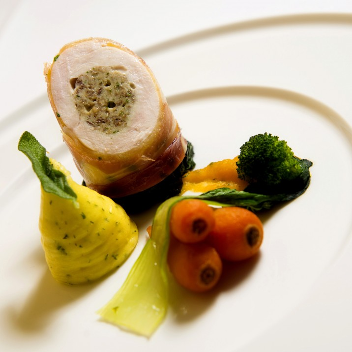A flavour sensation - this free range chicken and haggis roulade is served with herb mash and seasonal vegetables.