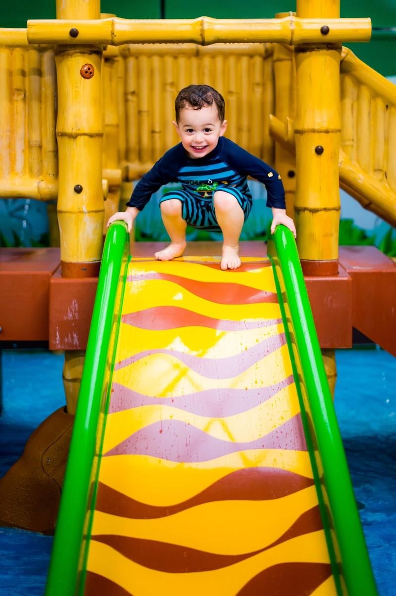 Swim and Skate - Little Boy on Slide