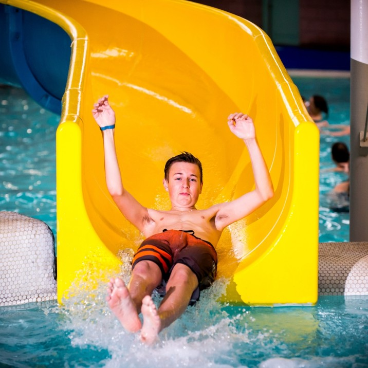 Boy sliding down the flume at Perth Leisure Pool.