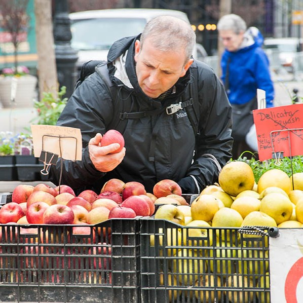 Somebody sampling the juicy, fresh apples from market stall in New York.