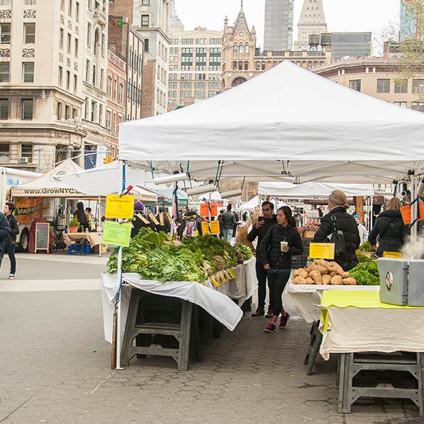 Gazebo stall with a range of fresh fruit and veg at the New York fruit market.
