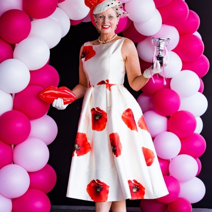 the best dressed lady at the 2016 Ladies Day at Perth Racecourse wowed in a poppy print dress with a gorgeous elegant hat, silk gloves and red heels.
