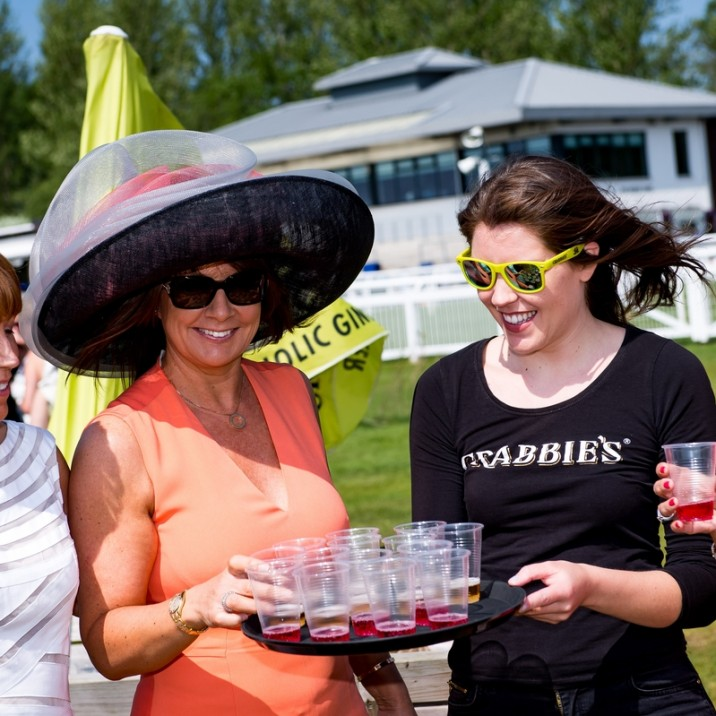 Now that's a hat! The drinks were flowing at Ladies day and the ladies looked gorgeous in big hats and bright dresses.