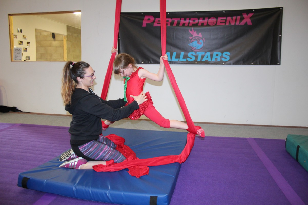Adventure Circus Gemma helping little girl