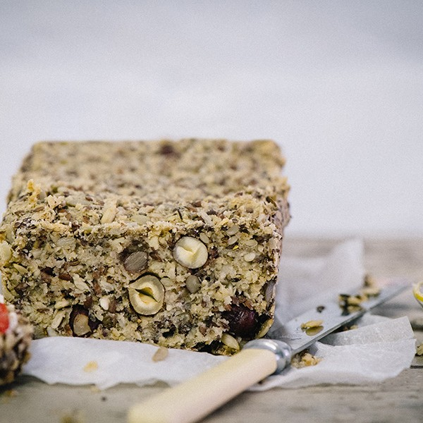 This close up view of this tasty bread shows all the healthy oats and seeds that make this gluten free, healthy alternative to bread packed with health benefits.