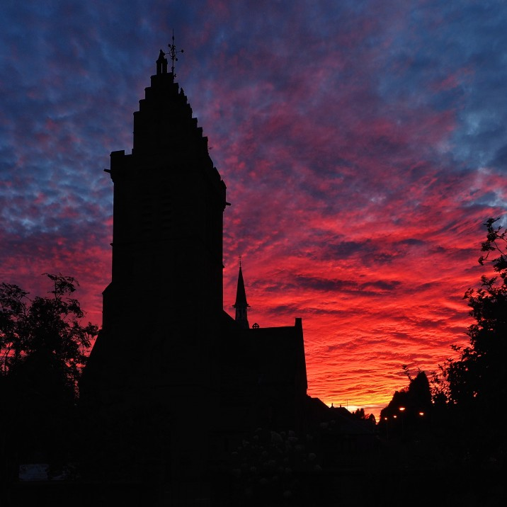 Tom Ryan took this picture of the shadow of Scone Kirk with the firey sky behind.  It almost looks like a dragon has blown fire into the sky.