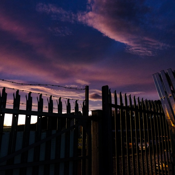 Thanks to Ian Sinclair for this picture.  The black fence is pointing upwards to the violet sky.