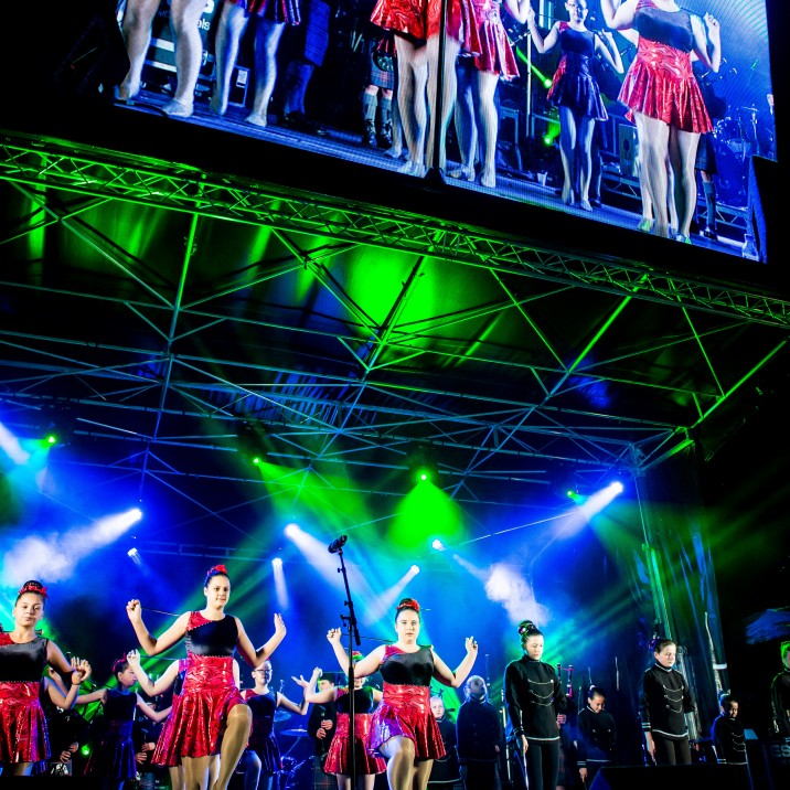 Energetic dancers put on a spectacular show on stage and big screen