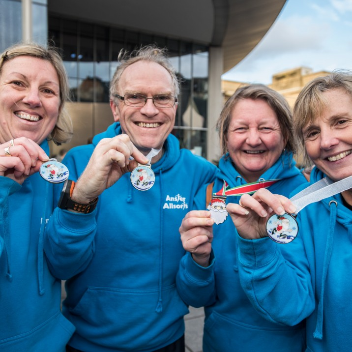The group from Anster Allsorts show off their finishers medals.
