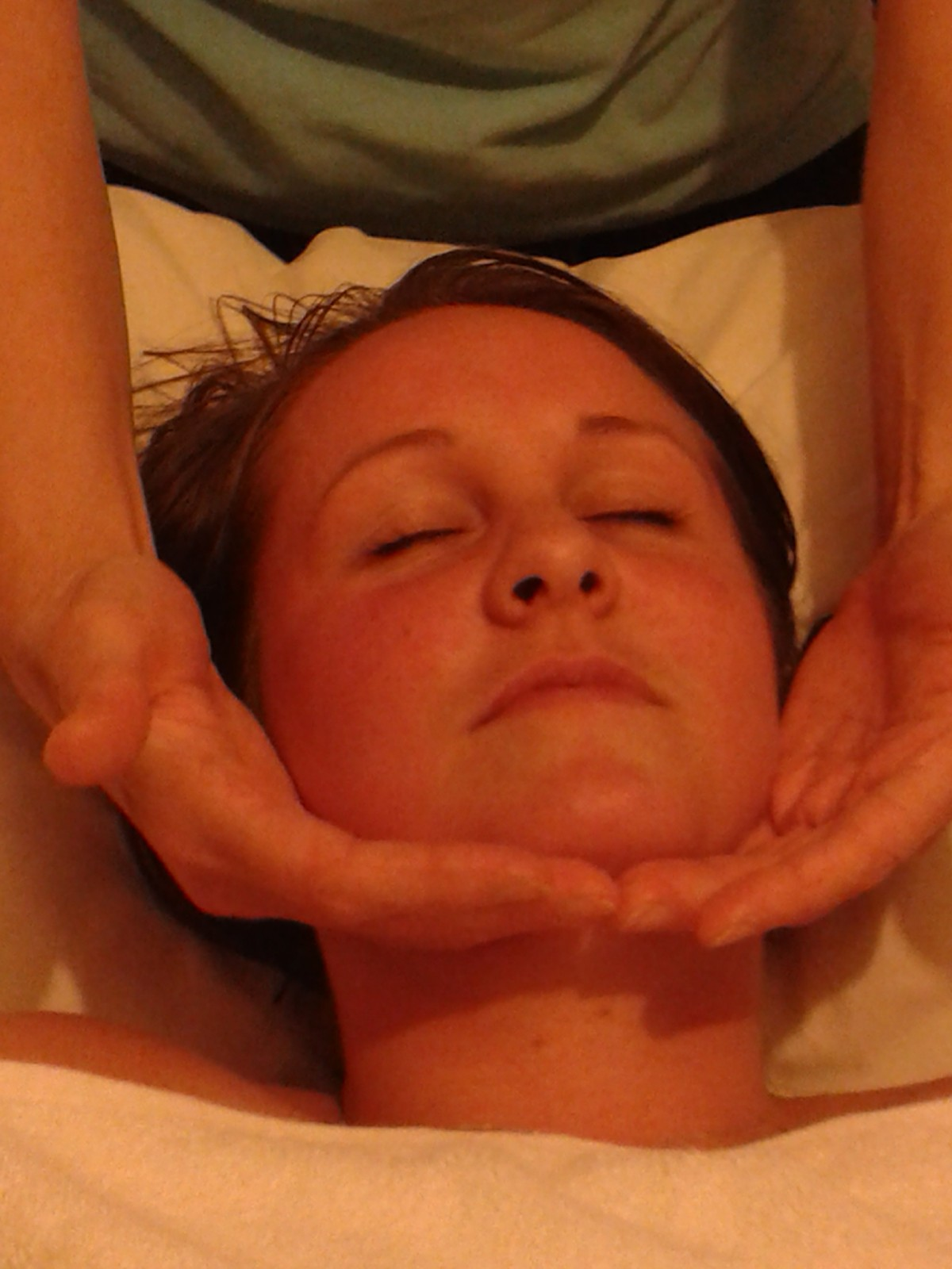 Taylored Massage face in hands