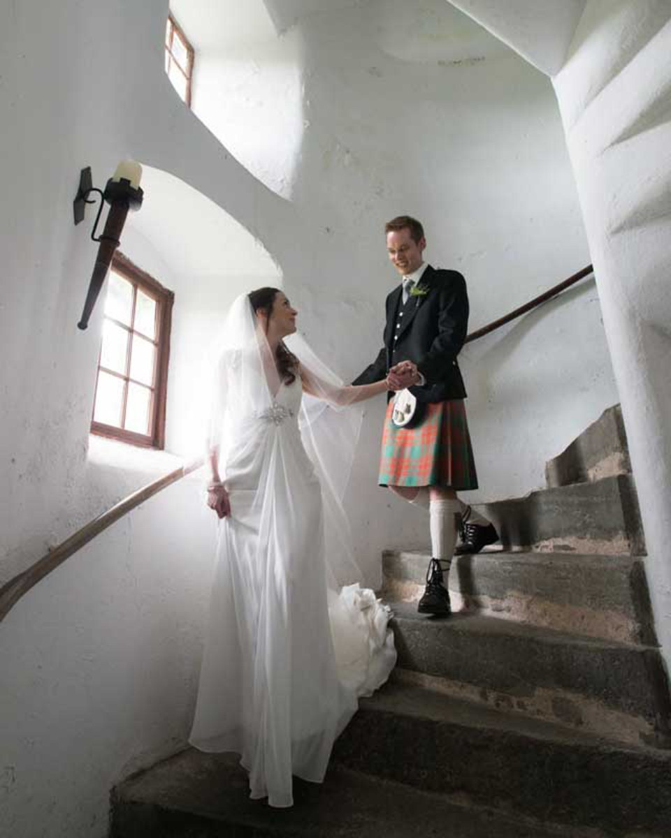 Neil Fordyce bride and groom coming down stairs