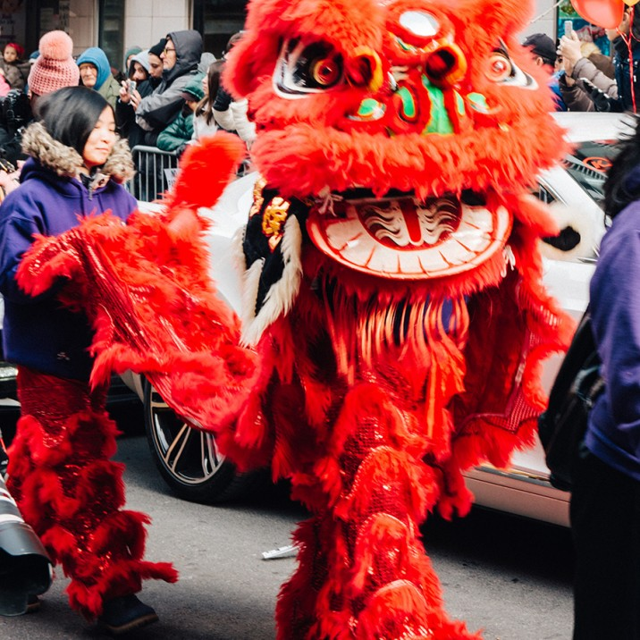 A beautiful red Chinese New Year dragon strutting down the streets of New York.