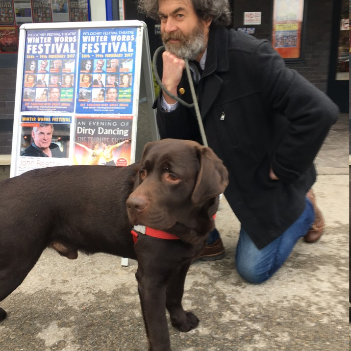 Dougal and his dog outside Pitlochry Festival Theatre with author Fiona Rintoul's beautiful chocolate labrador.