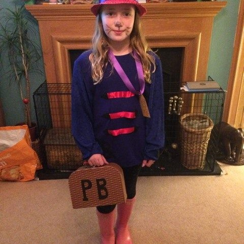 Lily looks the part as Paddington Bear-we love the little briefcase!