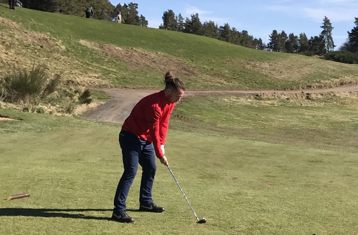 Stevie May teeing off