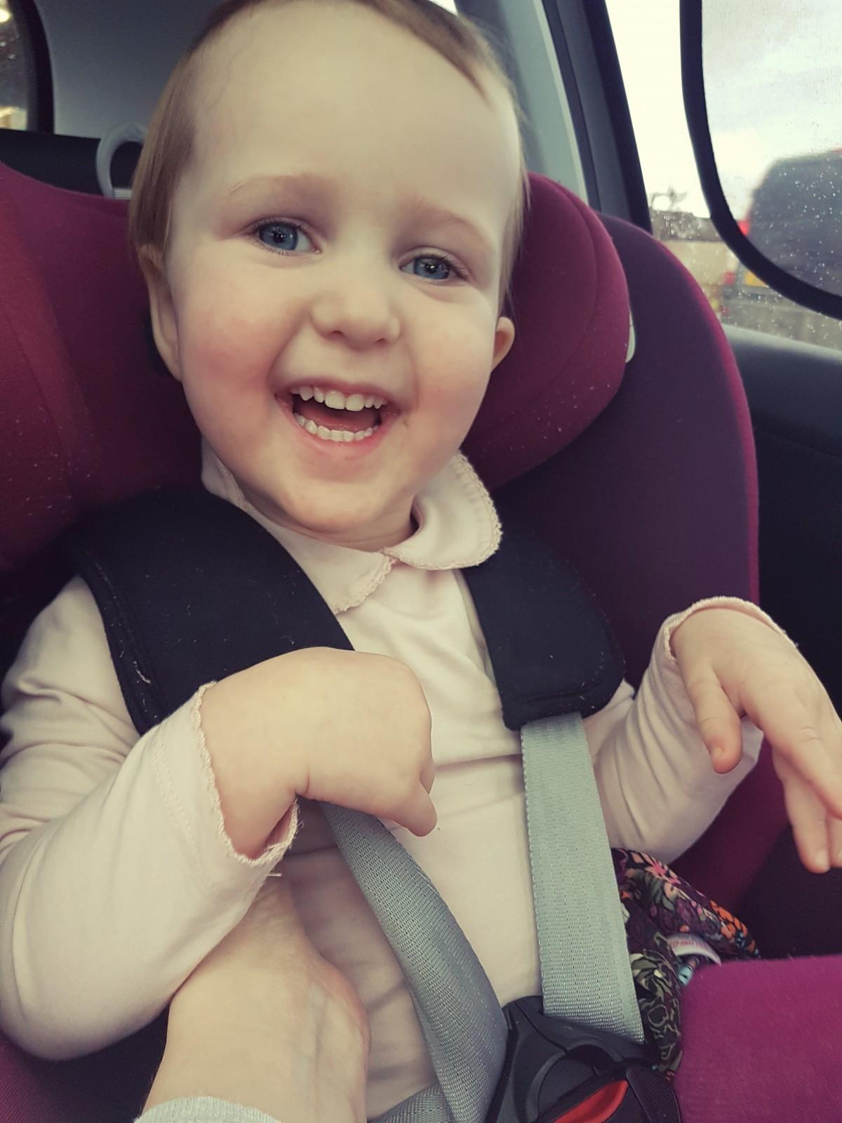 Freya smiles in car