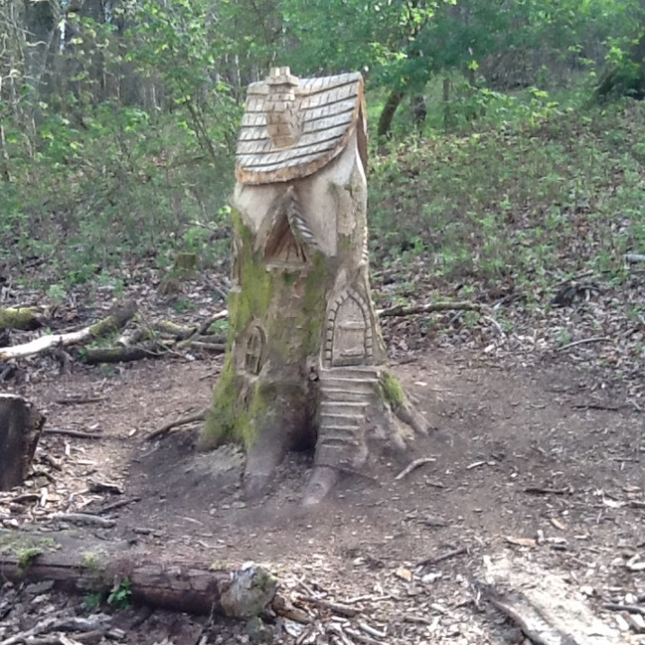 A LOVELY CARVED FAIRY HOUSE WITH AMAZING BACKROUND