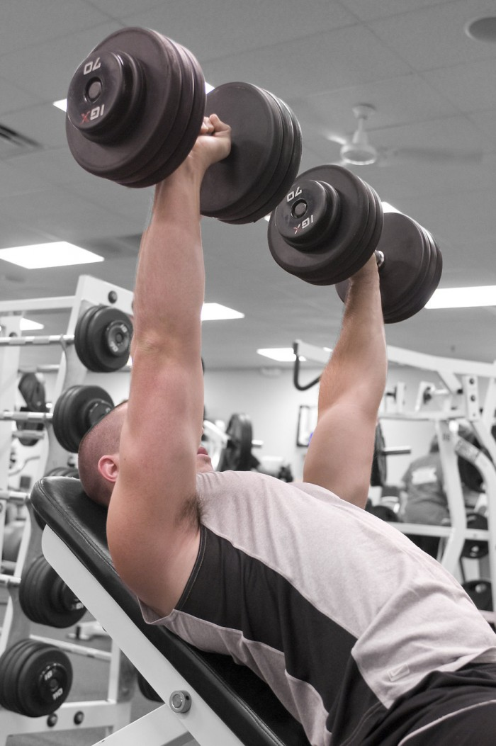 Weightlifting - Man lifting dumbbells