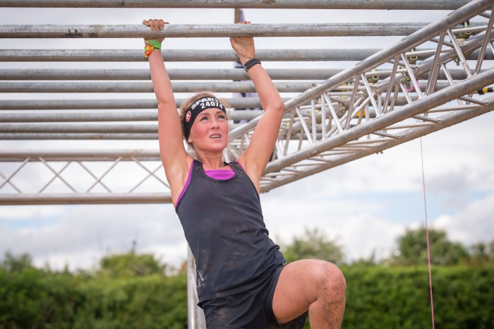 Spartan Race 2018 - woman on monkeybars