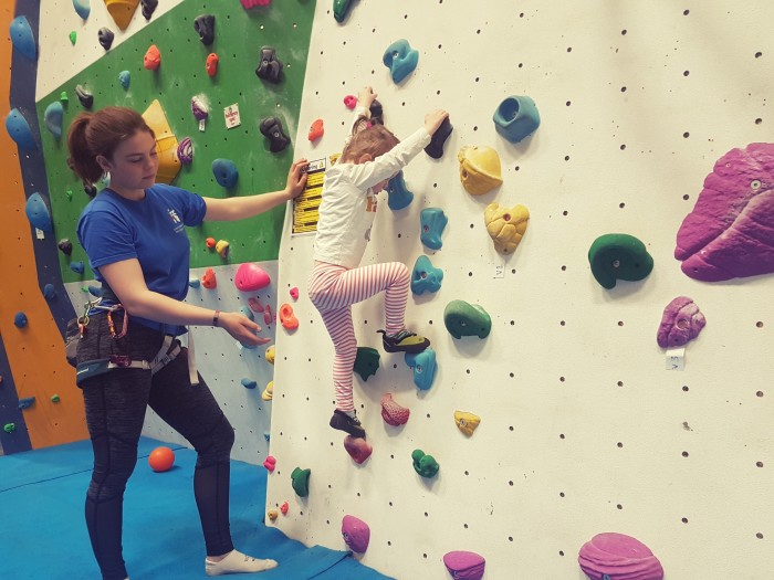 Climbing uses toddler core strength, grip and problem solving in one!