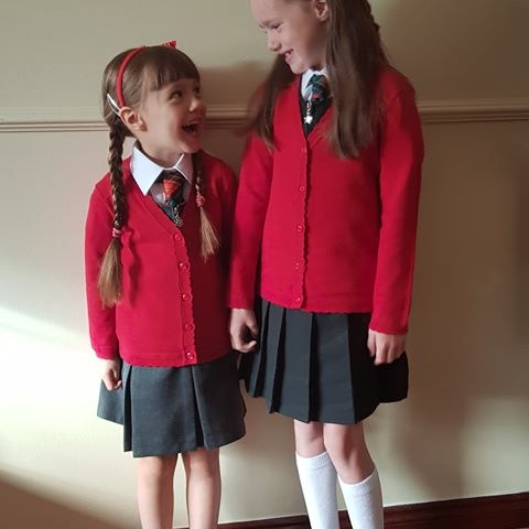 Lucy and big sis, Chloe are ready for school!