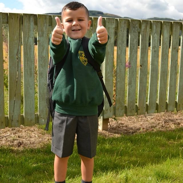 Ben puts his thumbs up in excitement as he starts his first day of Primary one at Dunbarney Primary, Perth