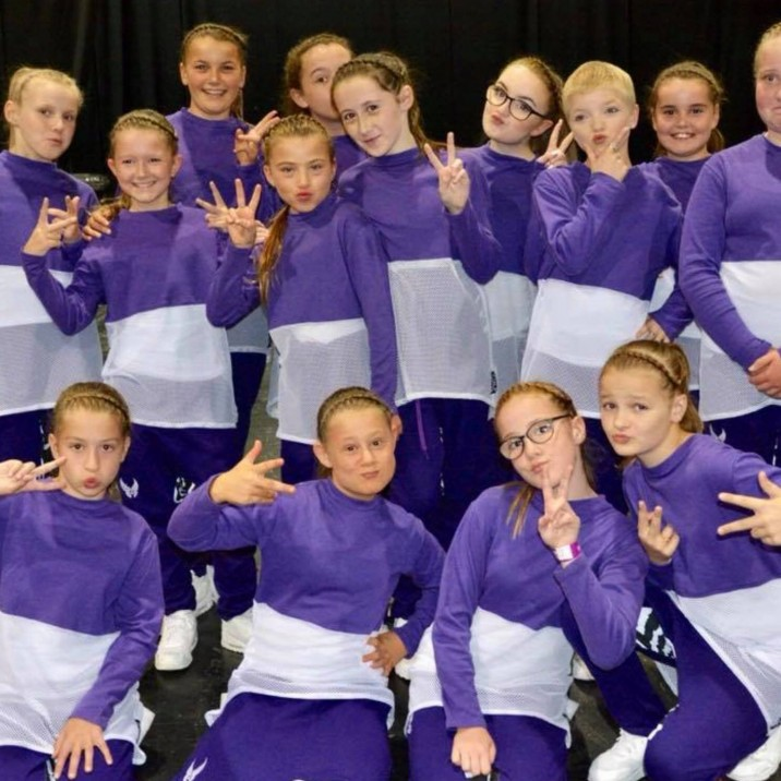 No Filter' from JGN Dance Studio in Perth City Centre huddled in their group and striking a pose after placing 7th in the world at the 2018 UDO World Championships!