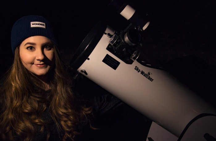 With her trusty telescope!