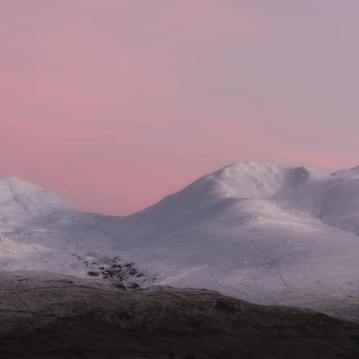 A gorgeous photograph of a red sky morning at Ben Lawers and Beinn Ghlas, Perthshire by Katherine Fotheringham