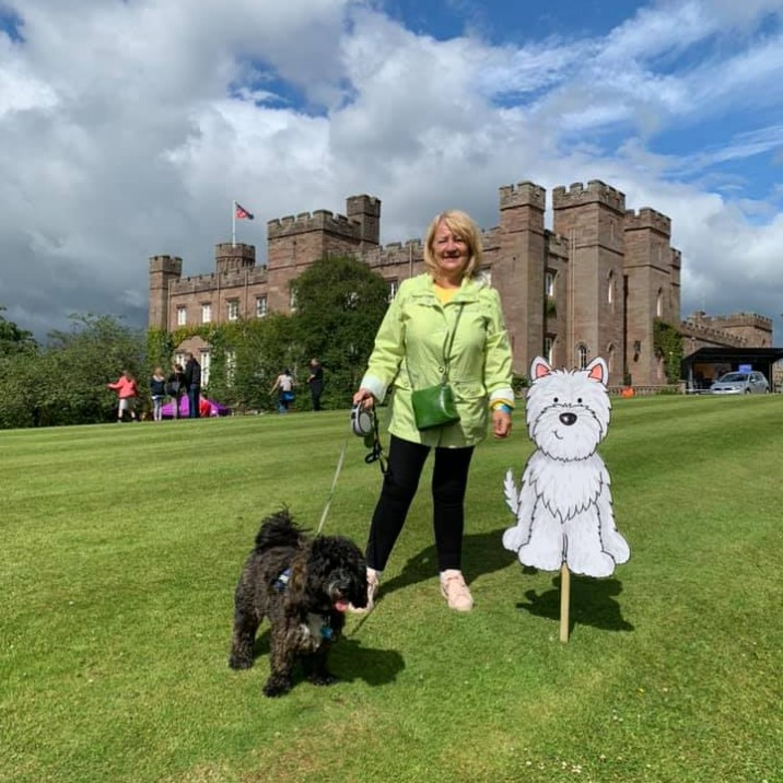 Gus the Cockapoo and his Gran having a great time at Paws at the Palace!