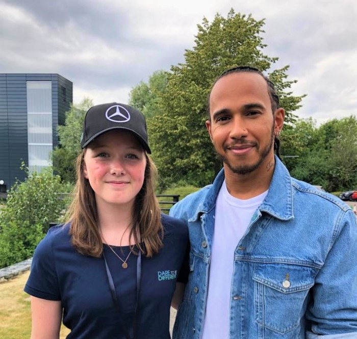Young karting talent Chloe Grant poses for a photograph Formula 1 racing driver Lewis Hamilton.
