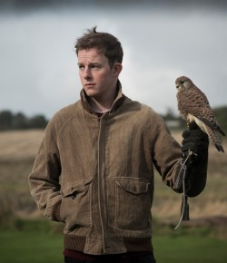 Danny Hughes who plays Billy Casper in Perth Theatre's upcoming production of Kes, gets ready for new role with some birds of prey.